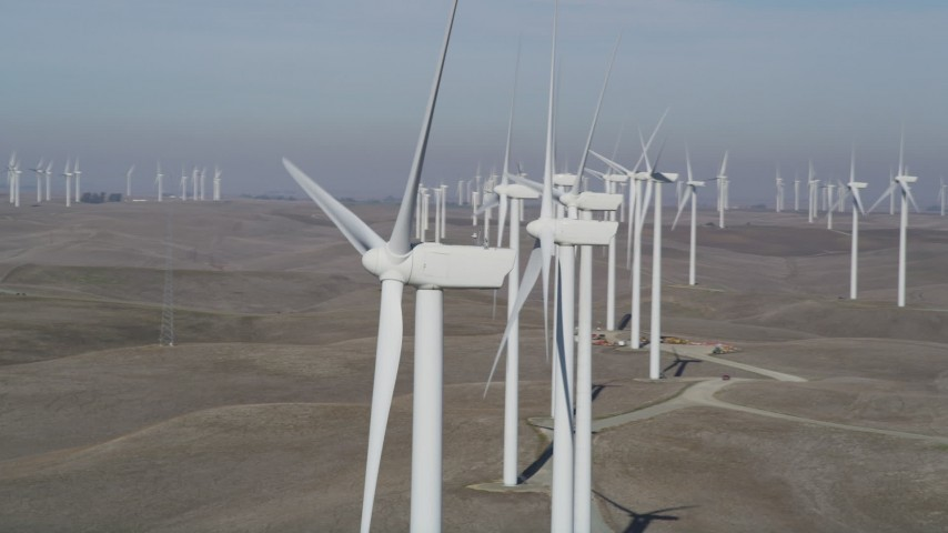 5K stock footage aerial video of flying by windmills at the Shiloh Wind Power Plant, Montezuma Hills, California Aerial Stock Footage | DFKSF08_092