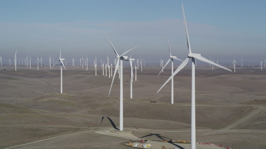5K stock footage aerial video flyby windmills while zooming out at Shiloh Wind Power Plant, Montezuma Hills, California Aerial Stock Footage | DFKSF08_094