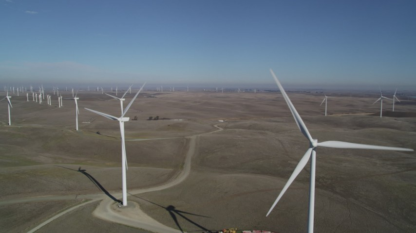 5K stock footage aerial video passing windmills at Shiloh Wind Power Plant, Montezuma Hills, California Aerial Stock Footage | DFKSF08_095