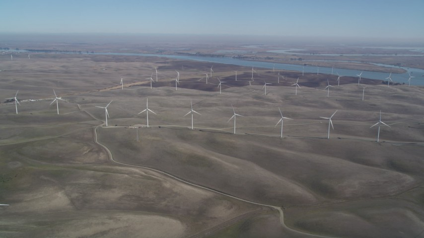 5K stock footage aerial video of flying by a field of windmills, Shiloh Wind Power Plant, Montezuma Hills, California Aerial Stock Footage | DFKSF08_097