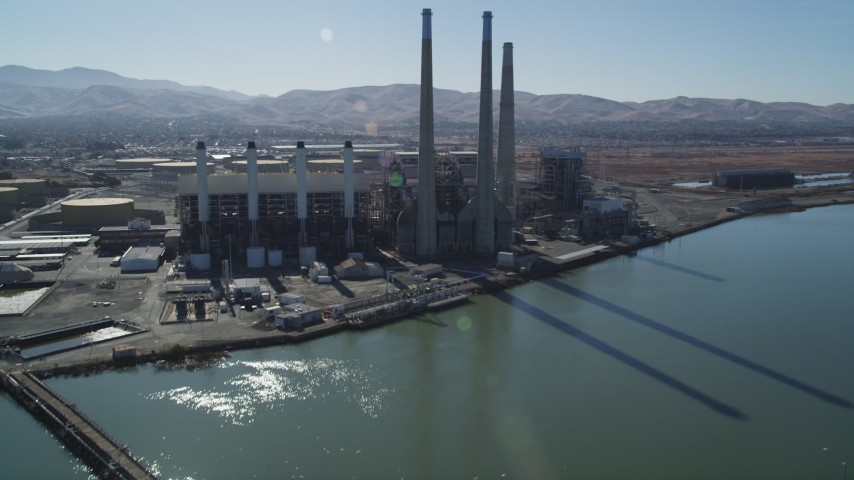 5K stock footage aerial video tilt from piers to reveal a power plant with smoke stacks in Pittsburg, California Aerial Stock Footage DFKSF08_099 | Axiom Images