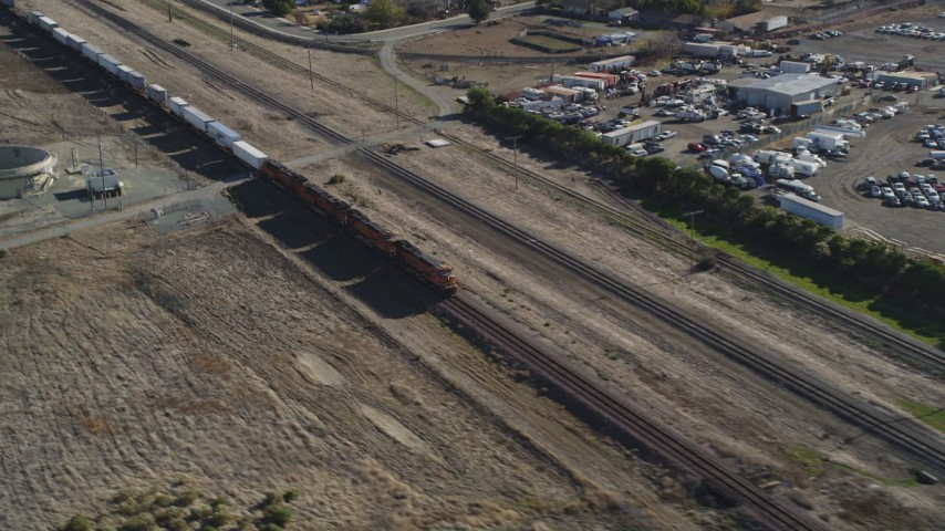 5K stock footage aerial video of passing in front of a moving train, Pittsburg, California Aerial Stock Footage | DFKSF08_104