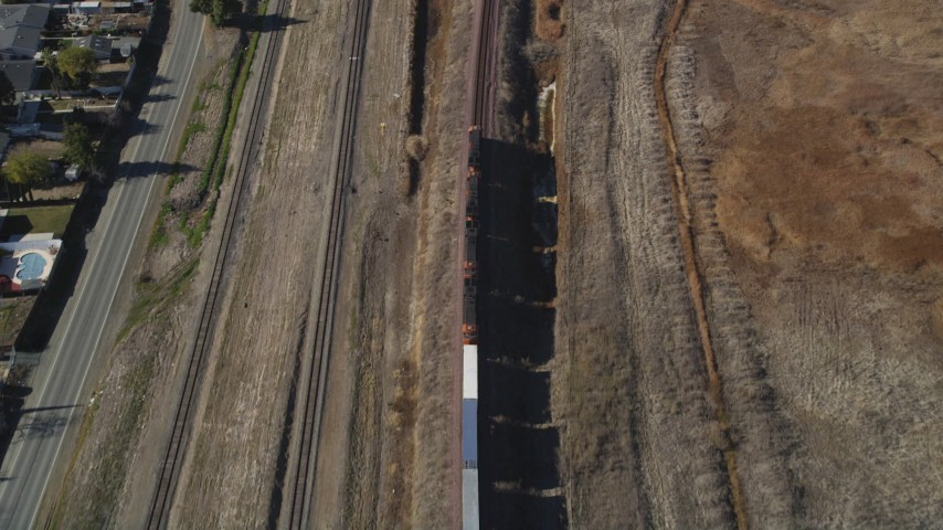 5K stock footage aerial video of tracking a train traveling through Pittsburg, California Aerial Stock Footage | DFKSF08_107