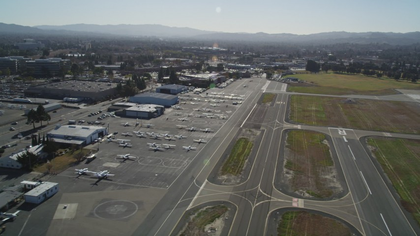5K stock footage aerial video of passing parked airplanes and hangars at Buchanan Field Airport, Concord, California Aerial Stock Footage   DFKSF08_114