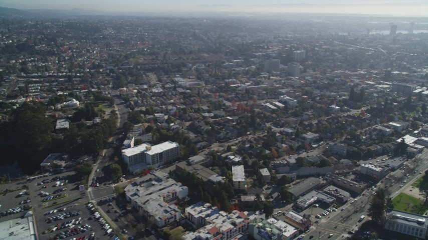 5K stock footage aerial video of panning across urban neighborhoods to reveal Broadway, Oakland, California Aerial Stock Footage | DFKSF09_012