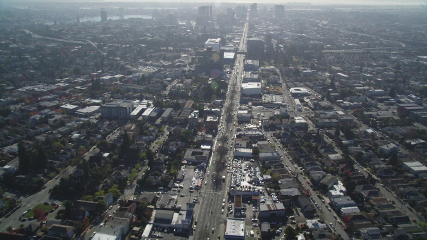 5K stock footage aerial video of following Broadway through the city in Oakland, California Aerial Stock Footage | DFKSF09_013