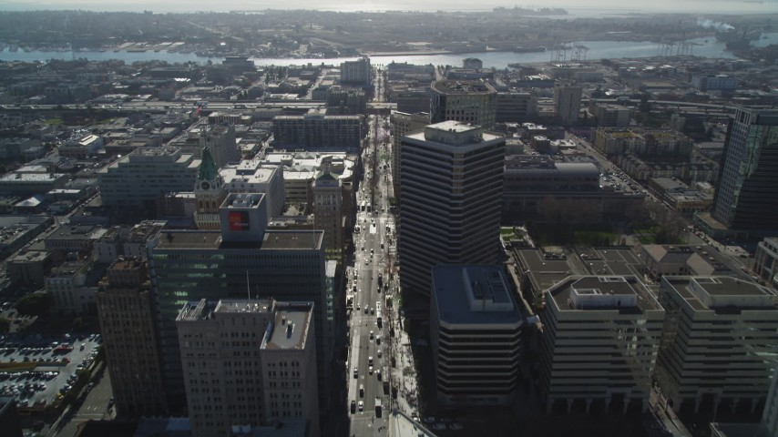 5K stock footage aerial video of tilting from Broadway to a wider view of the city, Downtown Oakland, California Aerial Stock Footage | DFKSF09_015