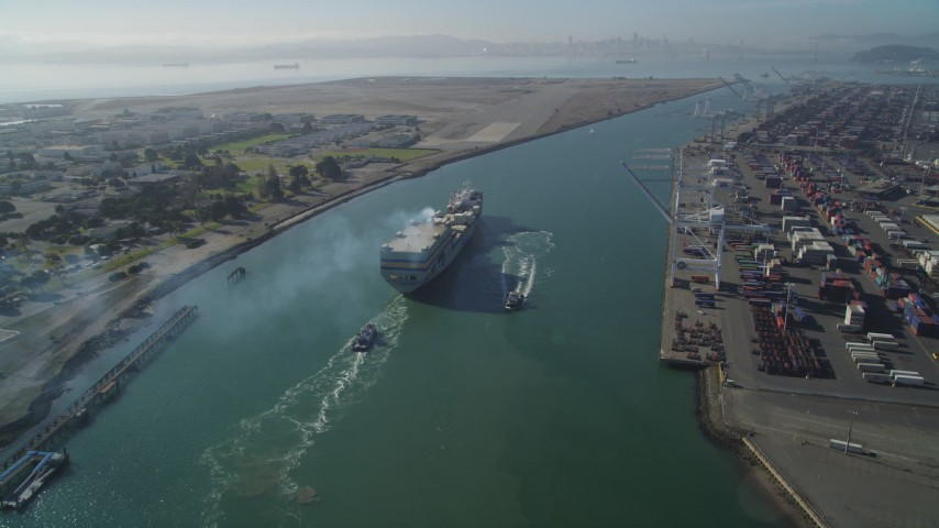 5K stock footage aerial video of tracking a cargo ship by the Port of Oakland, California Aerial Stock Footage DFKSF09_018 | Axiom Images