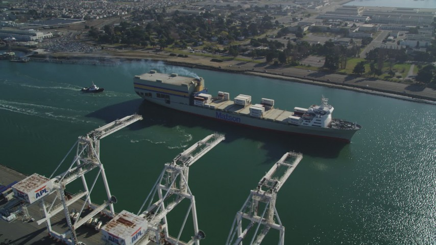 5K stock footage aerial video of a reverse view of a cargo ship passing cargo cranes in the Port of Oakland, California Aerial Stock Footage | DFKSF09_020