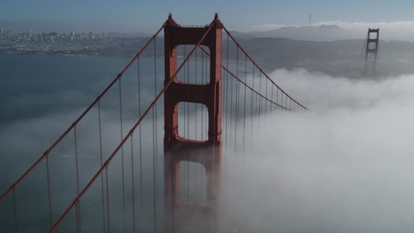 5K stock footage aerial video of flying above fog over Golden Gate Bridge, and reveal Downtown San Francisco, California Aerial Stock Footage | DFKSF09_026