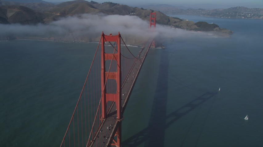 5K stock footage aerial video of the Golden Gate Bridge with light fog, San Francisco, California Aerial Stock Footage | DFKSF09_030