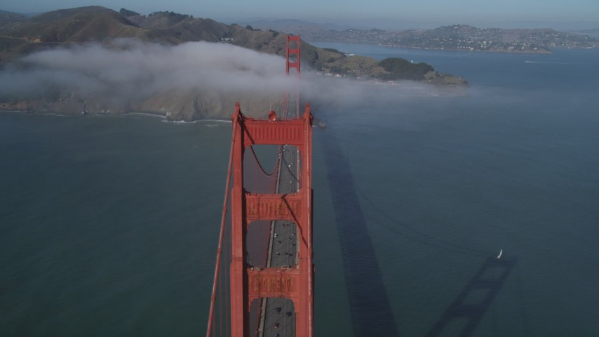 5K stock footage aerial video of flying by one of the Golden Gate Bridge towers and light fog, San Francisco, California Aerial Stock Footage | DFKSF09_031