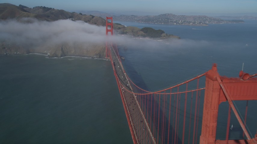 5K stock footage aerial video of a view of the fog-shrouded Marin side of the Golden Gate Bridge in San Francisco, California Aerial Stock Footage | DFKSF09_032