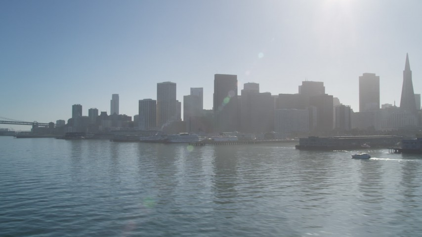5K stock footage aerial video flyby piers, with a view of the skyline in Downtown San Francisco, California Aerial Stock Footage | DFKSF09_044