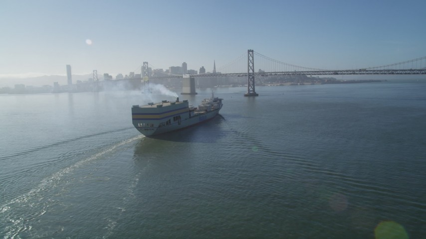 5K stock footage aerial video track a cargo ship approaching the Bay Bridge, San Francisco, California Aerial Stock Footage | DFKSF09_047