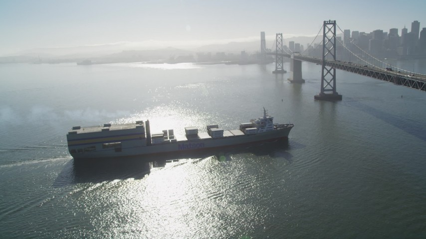 5K stock footage aerial video track a cargo ship approaching the Bay Bridge, San Francisco, California Aerial Stock Footage | DFKSF09_048