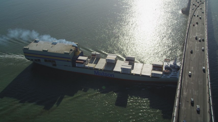 5K stock footage aerial video of tracking a cargo ship sailing under Bay Bridge, San Francisco, California Aerial Stock Footage | DFKSF09_049