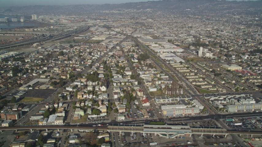 5K stock footage aerial video of flying by urban neighborhoods in Oakland, California Aerial Stock Footage | DFKSF09_057