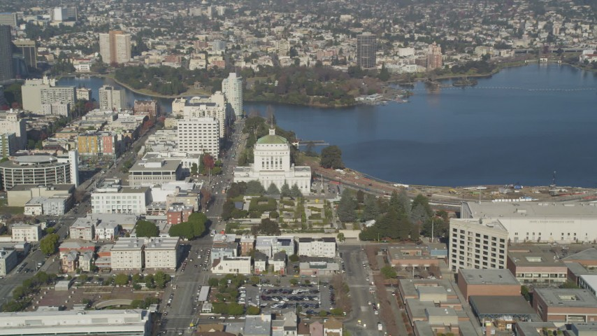 5K stock footage aerial video of flying by Lake Merritt and Downtown Oakland, California Aerial Stock Footage | DFKSF09_058