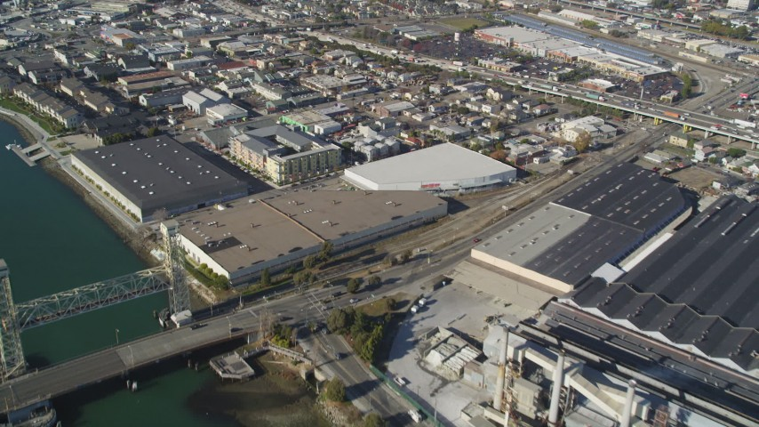 5K stock footage aerial video of flying away from factories and warehouses in Oakland, Alameda, California Aerial Stock Footage | DFKSF09_060