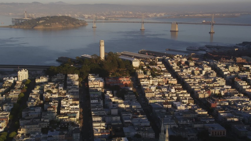 5K stock footage aerial video of zooming in on Coit Tower in North Beach, San Francisco, California, sunset Aerial Stock Footage | DFKSF10_003