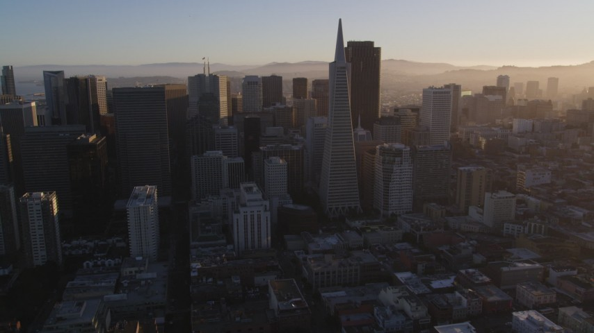 5K stock footage aerial video of flying by downtown skyscrapers and Transamerica Pyramid, Downtown San Francisco, California at sunset Aerial Stock Footage | DFKSF10_004