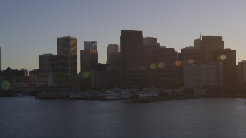 5K stock footage aerial video of waterfront skyscrapers and Ferry Building in Downtown San Francisco, California at sunset Aerial Stock Footage | DFKSF10_008