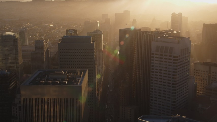 5K stock footage aerial video of flying over Market Street through Downtown San Francisco, California, sunset Aerial Stock Footage | DFKSF10_010