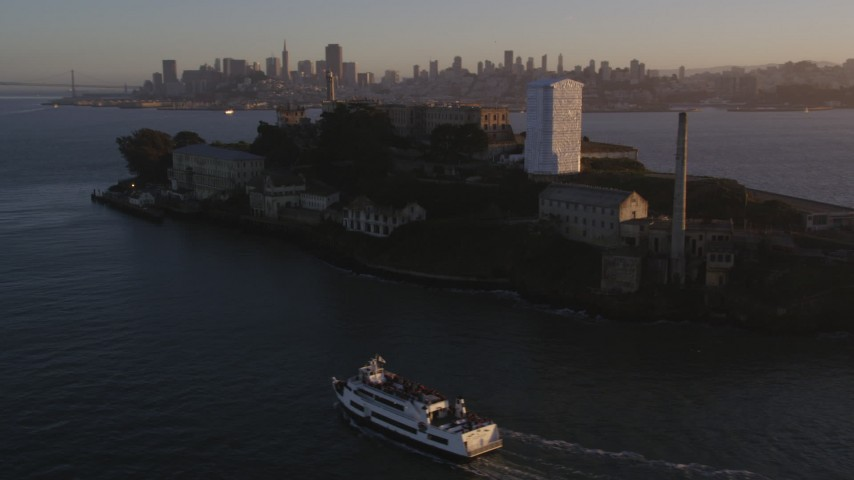 5K stock footage aerial video of flying by Alcatraz prison in San Francisco, California, sunset Aerial Stock Footage | DFKSF10_018