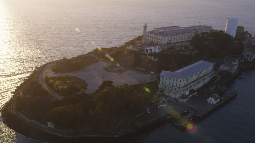 5K stock footage aerial video of flying over Alcatraz island prison in San Francisco, California, sunset Aerial Stock Footage | DFKSF10_019