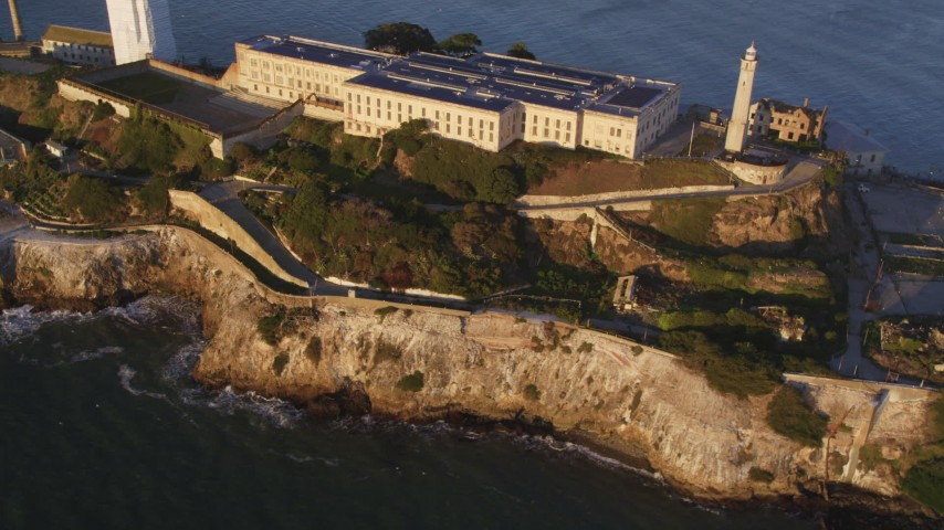 5K stock footage aerial video of flying by and away from Alcatraz island prison in San Francisco, California, sunset Aerial Stock Footage | DFKSF10_020