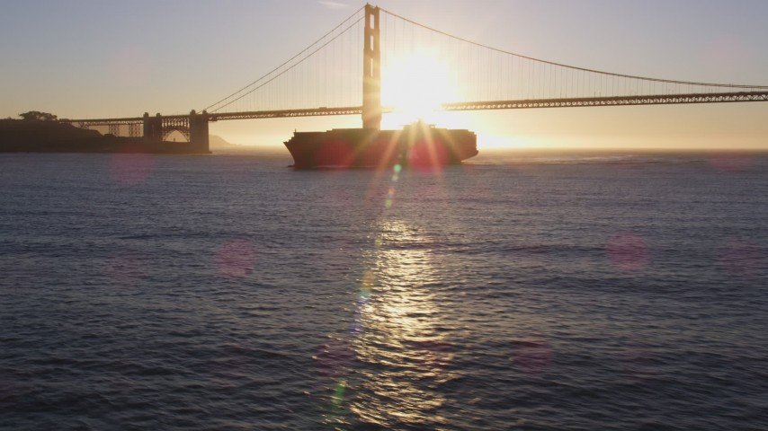 5K stock footage aerial video of a cargo ship near Golden Gate Bridge, San Francisco, California, sunset Aerial Stock Footage | DFKSF10_021