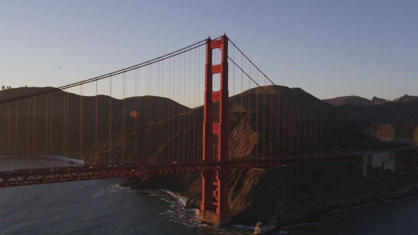 5K stock footage aerial video of flying by Marin side of Golden Gate Bridge, San Francisco, California, sunset Aerial Stock Footage | DFKSF10_022