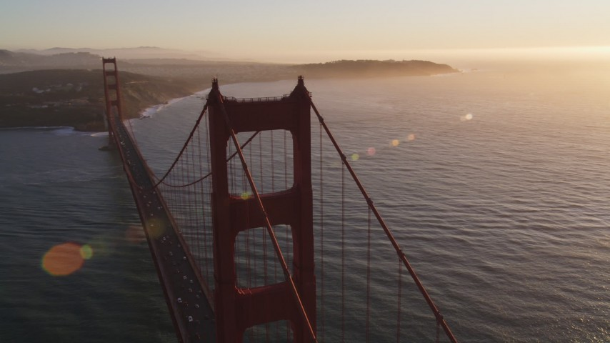 5K stock footage aerial video of flying over Golden Gate Bridge, reveal cargo ship, San Francisco, California, sunset Aerial Stock Footage | DFKSF10_023