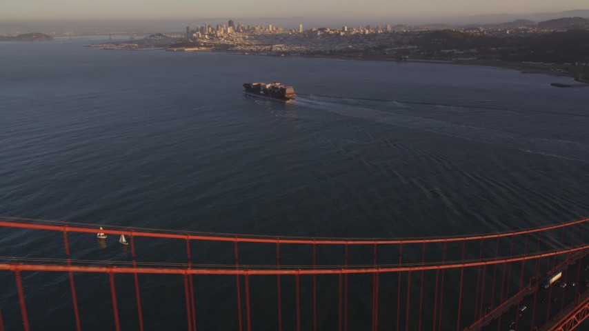 5K stock footage aerial video of cargo ship on San Francisco Bay, seen from Golden Gate Bridge, San Francisco, California, sunset Aerial Stock Footage | DFKSF10_024