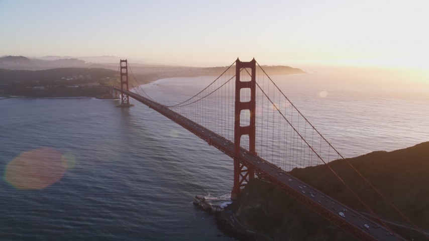 5K stock footage aerial video of a reverse view of the Golden Gate Bridge and setting sun in San Francisco, California Aerial Stock Footage | DFKSF10_030