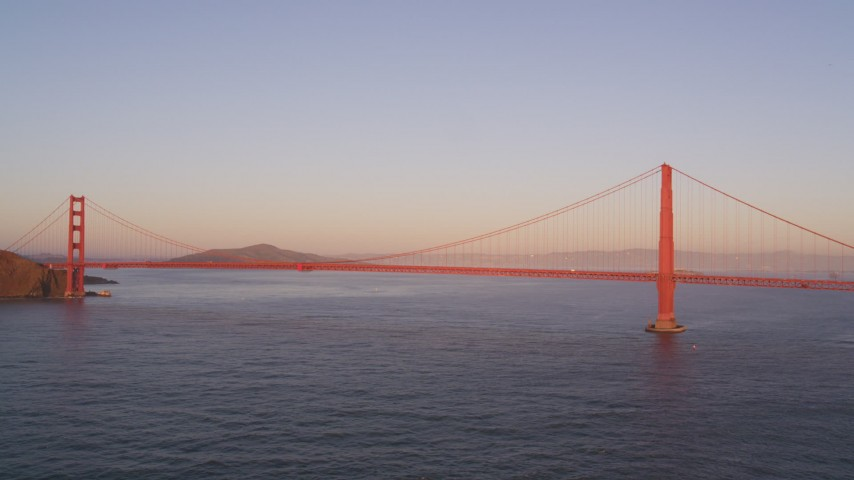 5K stock footage aerial video of flying away from iconic Golden Gate Bridge in San Francisco, California, at sunset Aerial Stock Footage | DFKSF10_034