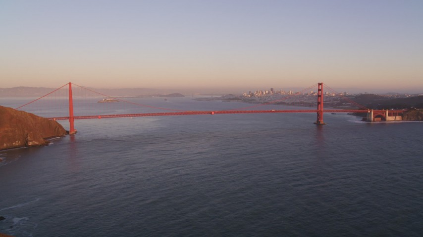 5K stock footage aerial video of a wide view of the Golden Gate Bridge, San Francisco, California, sunset Aerial Stock Footage | DFKSF10_036