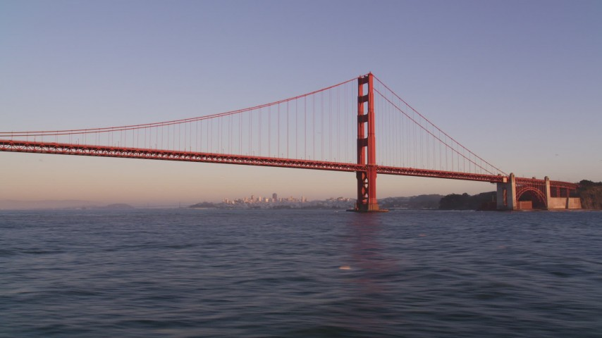 5K aerial video of flying low over the Bay by Golden Gate Bridge, San Francisco, California, sunset Aerial Stock Footage   DFKSF10_037