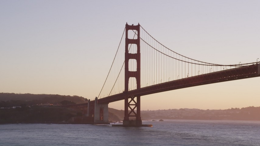 5K stock footage aerial video of the Presidio side of iconic Golden Gate Bridge, San Francisco, California, sunset Aerial Stock Footage | DFKSF10_039
