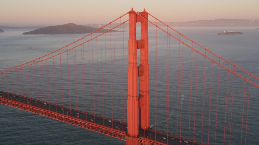 5K stock footage aerial video of flying by one tower of the Golden Gate Bridge, San Francisco, California, sunset Aerial Stock Footage | DFKSF10_041
