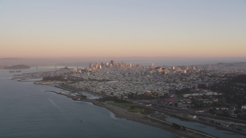5K stock footage aerial video of approaching the Downtown San Francisco skyline at sunset, California Aerial Stock Footage | DFKSF10_043