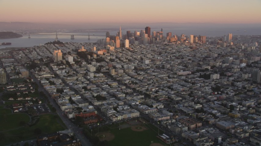 5K stock footage aerial video of approaching Russian Hill and Downtown San Francisco skyscrapers, California, sunset Aerial Stock Footage | DFKSF10_044