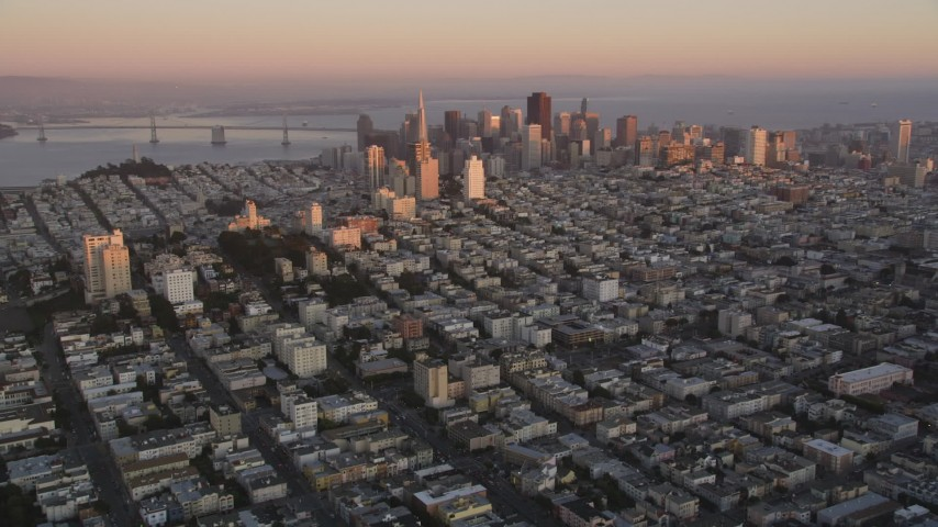 5K stock footage aerial video approach Russian Hill apartment buildings and Downtown San Francisco skyscrapers, California, sunset Aerial Stock Footage | DFKSF10_045