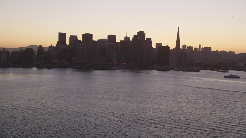 5K stock footage aerial video of the Ferry Building and Downtown San Francisco skyline, California, sunset Aerial Stock Footage | DFKSF10_054