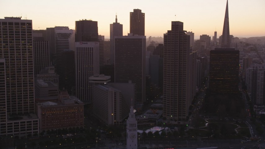 5K stock footage aerial video of approaching skyscrapers in Downtown San Francisco, California, sunset Aerial Stock Footage | DFKSF10_056