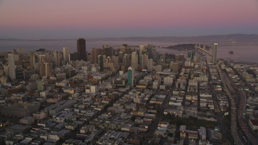 5K stock footage aerial video of approaching Downtown San Francisco skyscrapers, California, twilight Aerial Stock Footage | DFKSF10_058