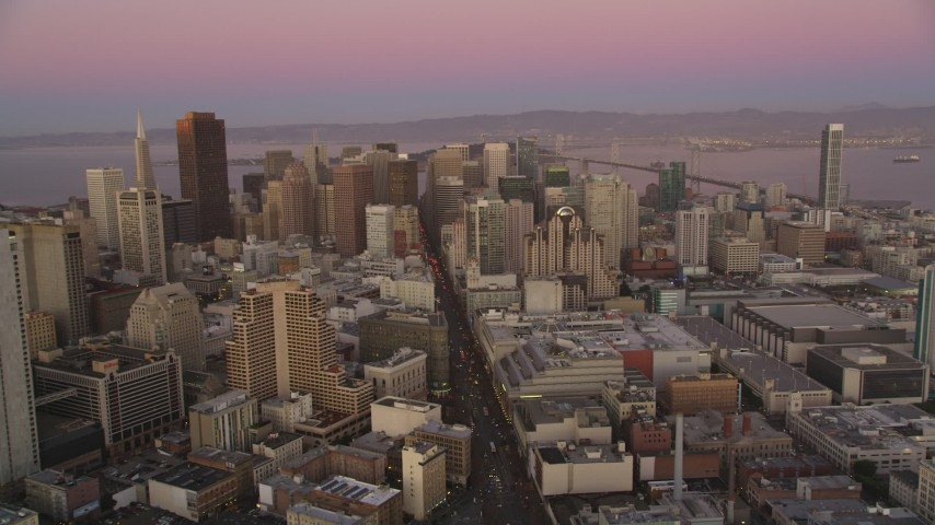 5K stock footage aerial video of flying over Market Street through Downtown San Francisco, California, twilight Aerial Stock Footage | DFKSF10_059