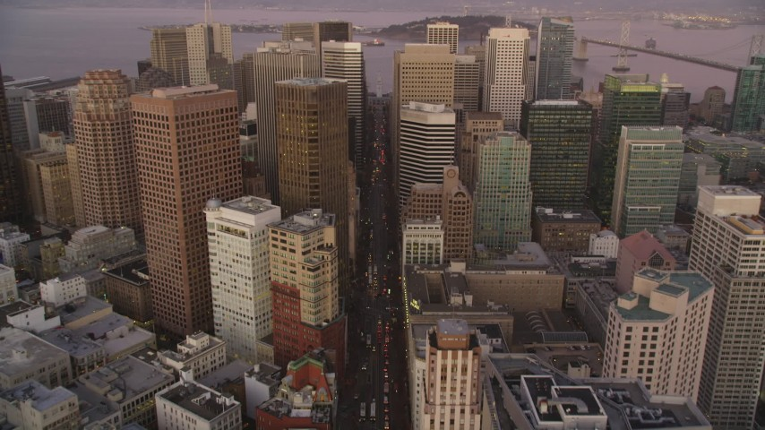 5K stock footage aerial video tilt from Market Street revealing Downtown San Francisco skyscrapers, California, twilight Aerial Stock Footage | DFKSF10_060