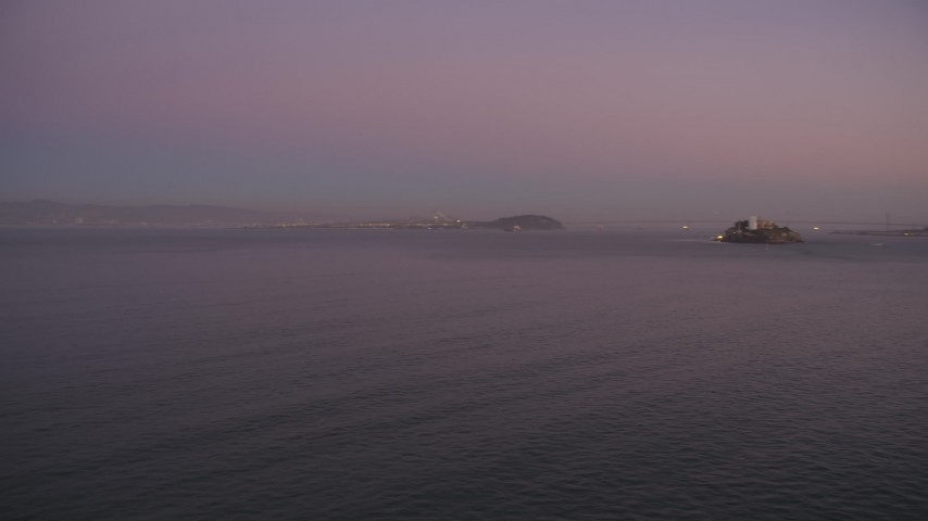 5K stock footage aerial video pan across San Francisco Bay, reveal Alcatraz and Downtown San Francisco skyline, California, twilight Aerial Stock Footage | DFKSF10_068